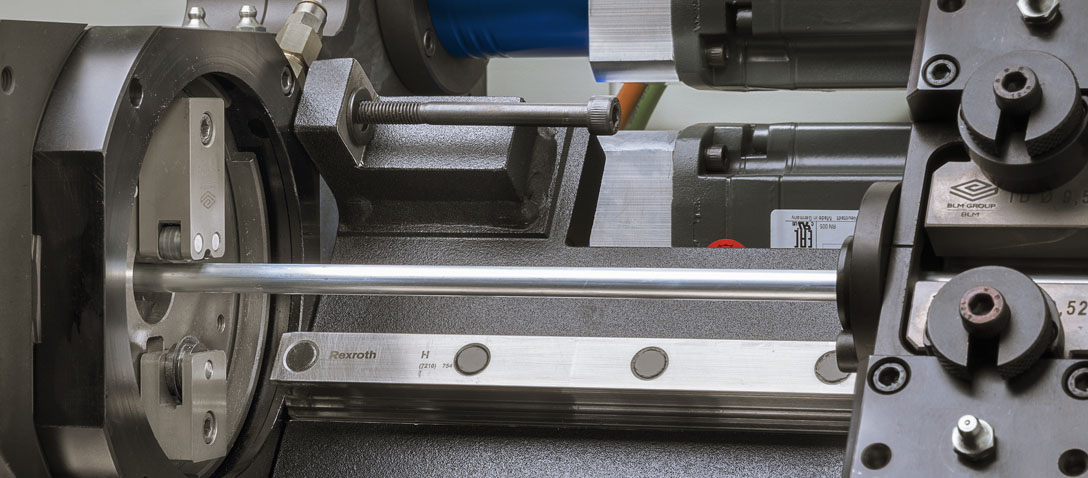 Orbital coil-fed tube pre-scoring system