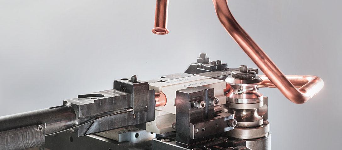 Doblado de tubos a partir de bobina con una máquina de dobladora de tubos automática CNC