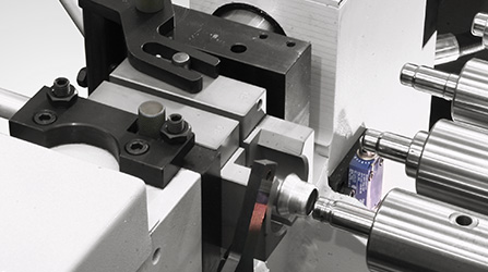 Tube end-forming machine clamp