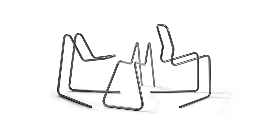 Seating made with a tube bending machine with right-hand and left-hand in-process bending capabilities